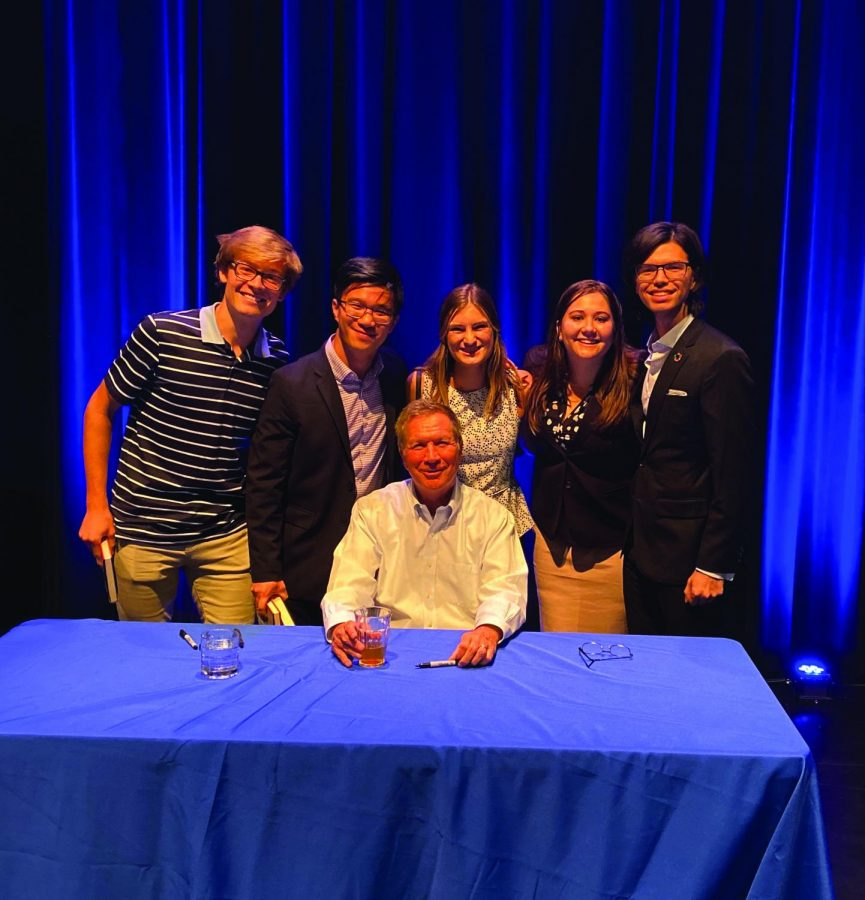 Debate team members attend a lecture at UCSB with John Kasich.