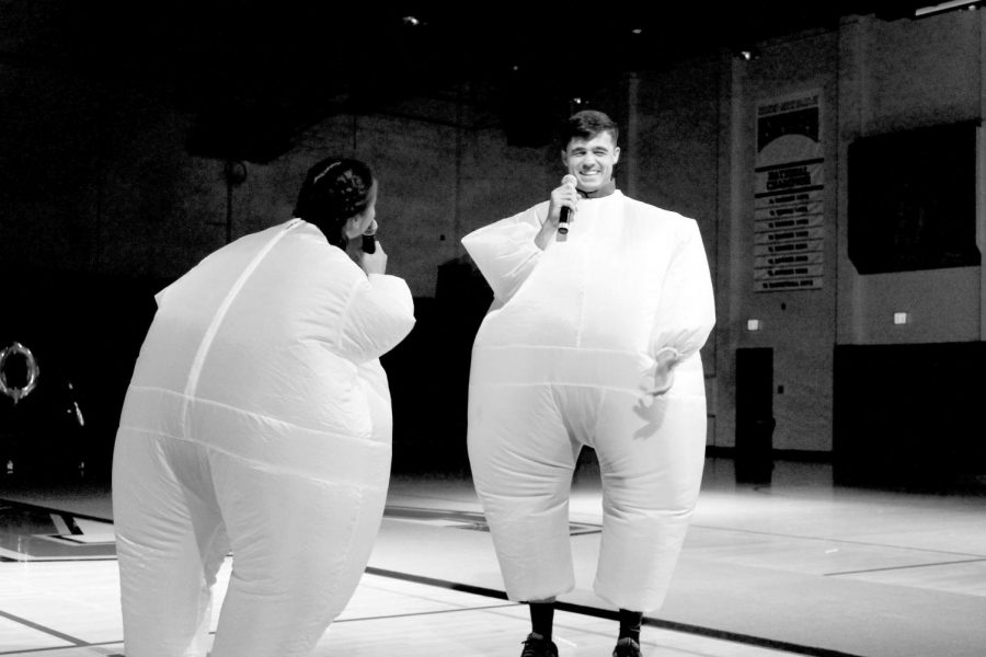Kiani Hildebrandt and Tim Heiduk host Midnight Madness in inflatable sumo wrestler suits.