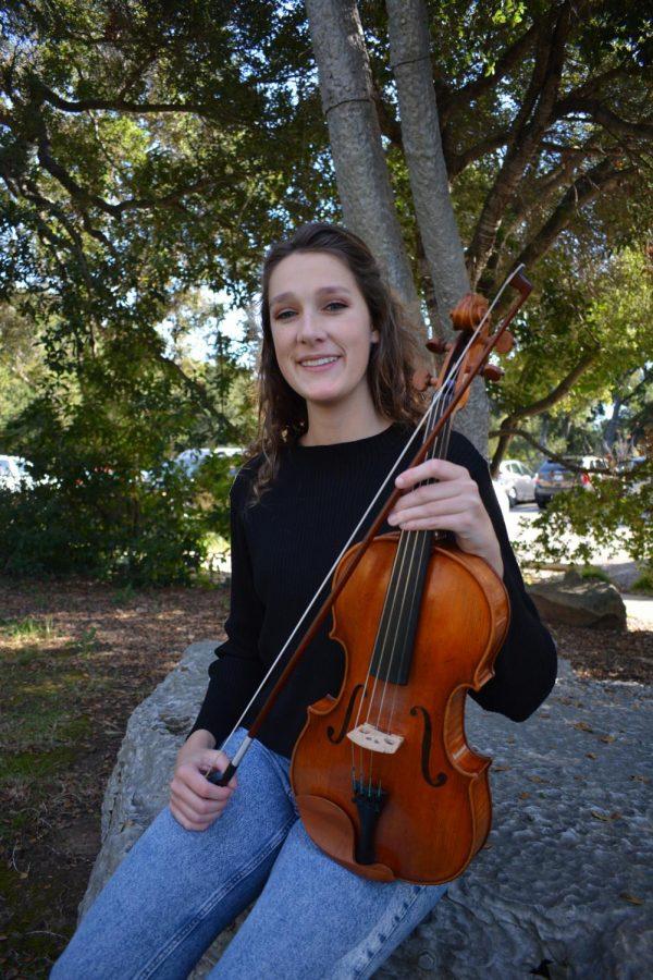 Eve Reiner posing with her viola.