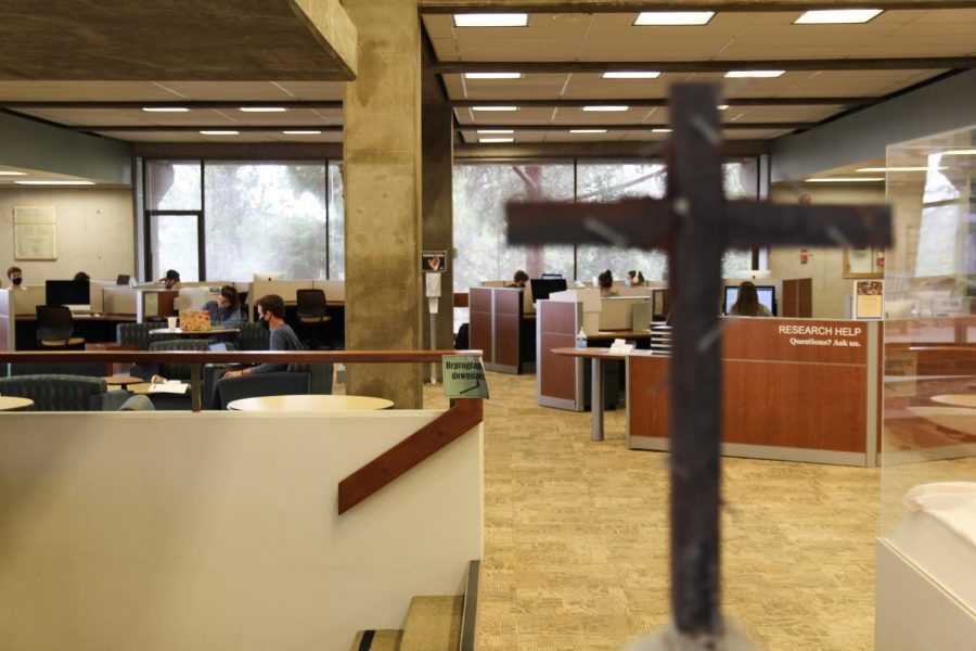 The Voskuyl Library as seen from the entrance. Masked students work in the background.