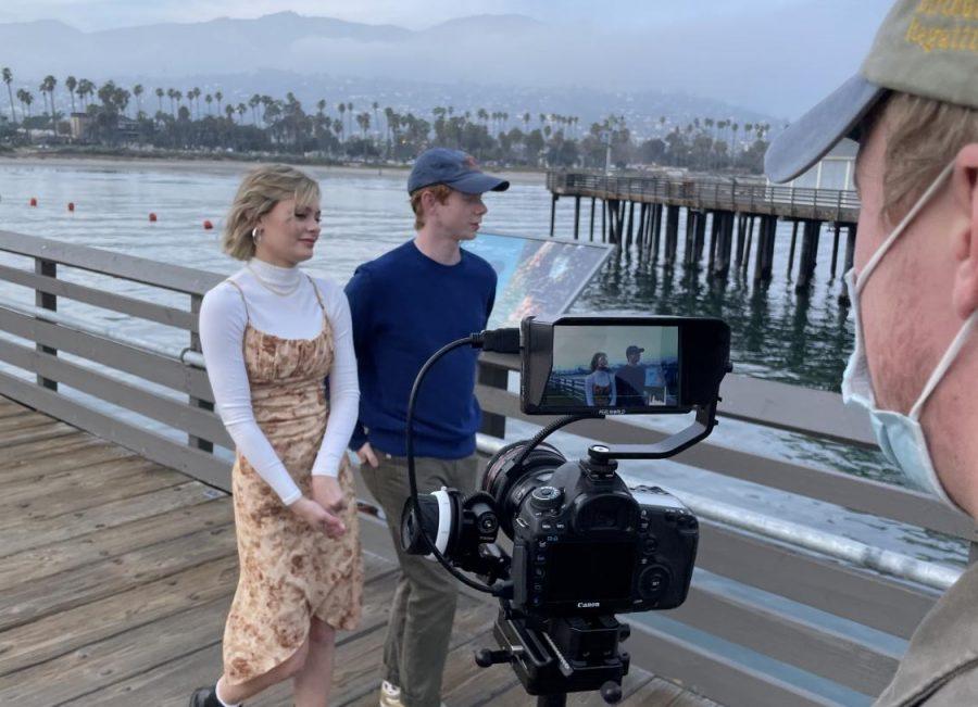 Junior Emi Brewer and Sophomore Landon Moir on set