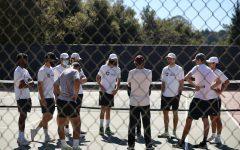 The tennis team discusses their game plan.