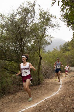 Adam King (left) running Cross Country