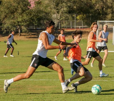 Mens soccer players battle it out during practice, gearing up for some tough games ahead.