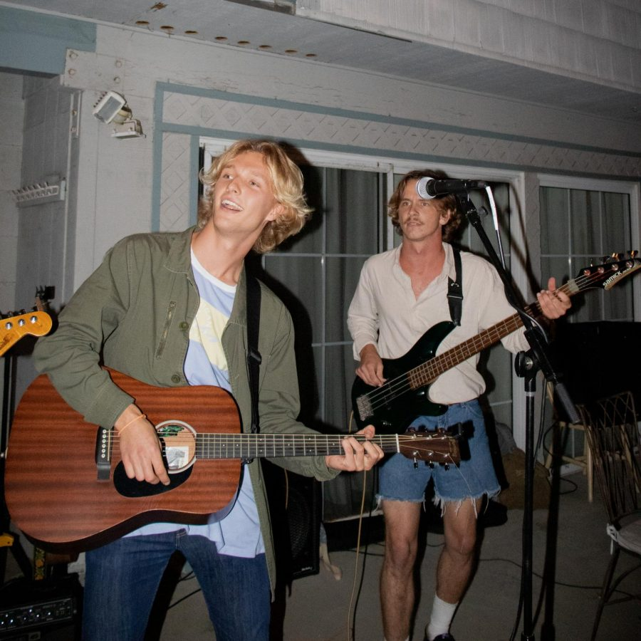 Juniors Will Grubbs (left) and Jesse Makuakane (right) play acoustic guitar and bass, respectively.